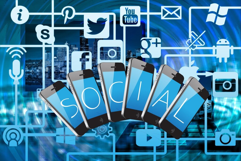 social media icons with 6 mobile phones with the word social - website traffic